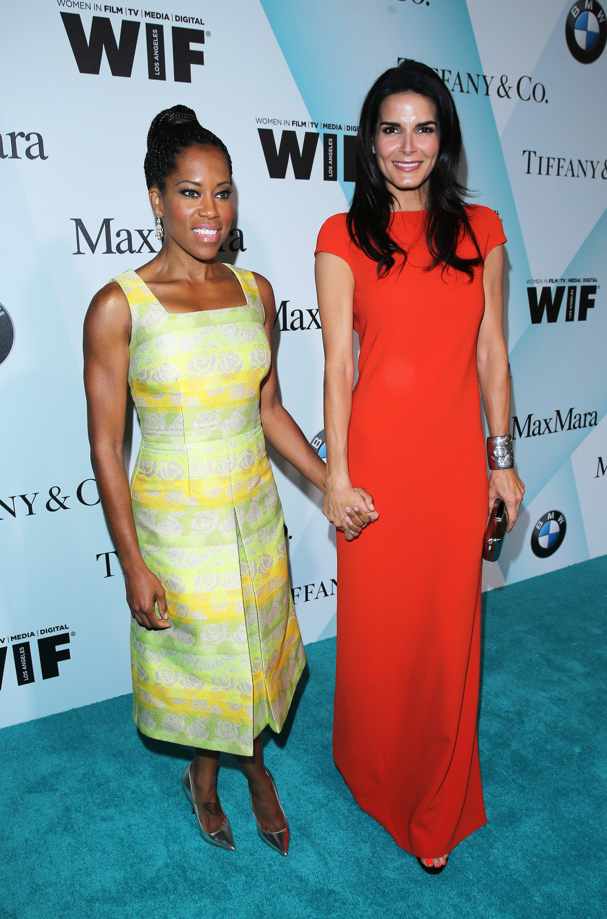 CENTURY CITY, CA - JUNE 16:  Actors Regina King (L) and Angie Harmon attend Women In Film 2015 Crystal + Lucy Awards Presented by Max Mara, BMW of North America, and Tiffany & Co. at the Hyatt Regency Century Plaza on June 16, 2015 in Century City, California.  (Photo by Mark Davis/Getty Images for Women in Film)