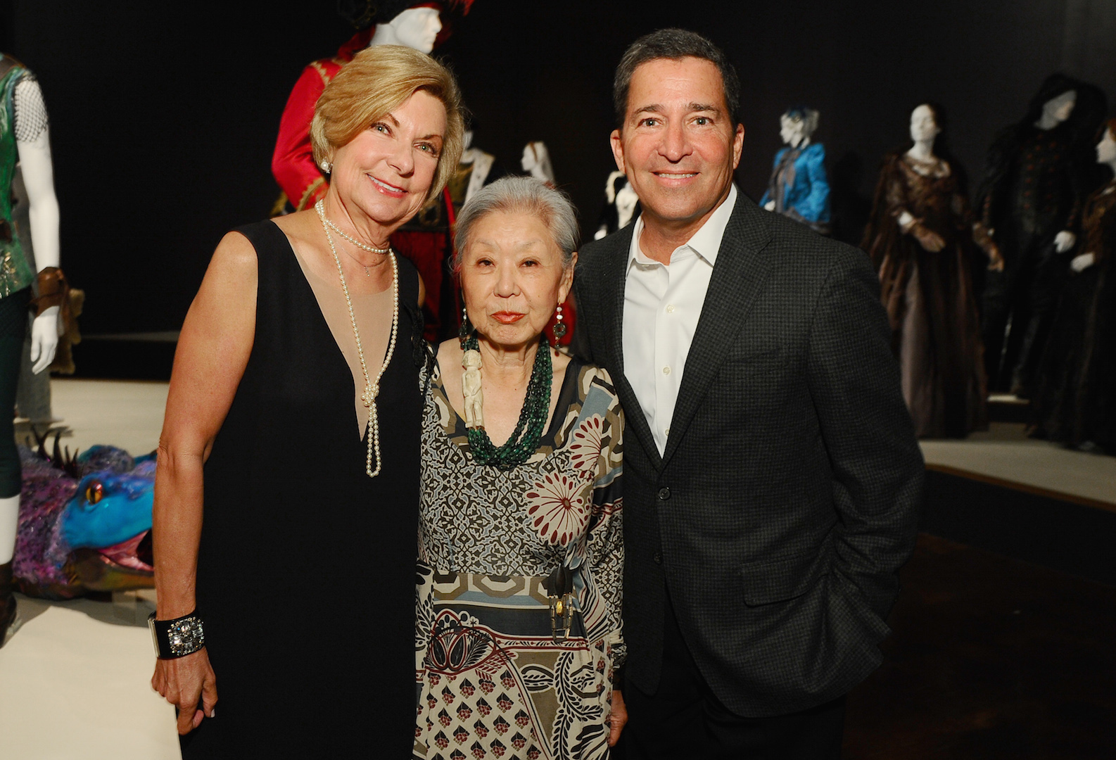Barbara Bundy, FIDM museum director, from left, Mary Rose and Bruce Rosenblum, chairman and CEO of the Television Academy, seen at The 9th Annual Outstanding Art of Television Costume Design Exhibition opening at the FIDM Museum & Galleries on the Park on Saturday, July 18, 2015, in Los Angeles. The Television Academy and FIDM Museum honored this year's Emmy(R) Award winners in Outstanding Costume Design at the opening reception for this annual special exhibition. (Photo by Vince Bucci/Invision for the Television Academy/AP Images)