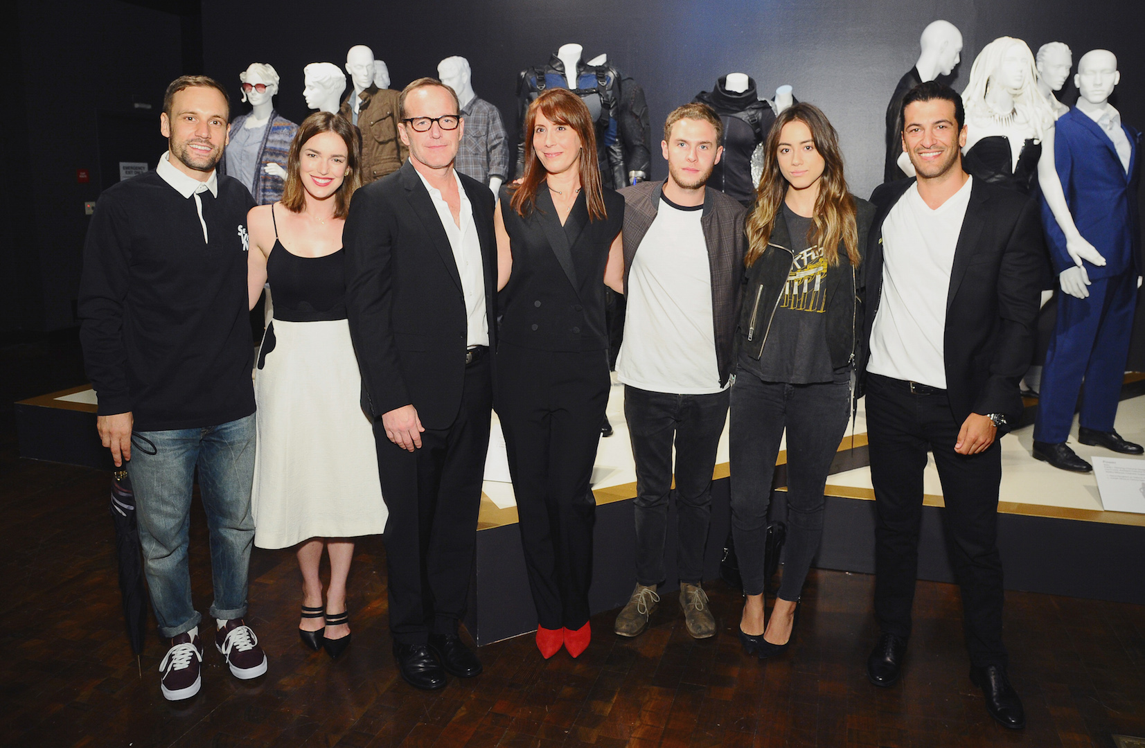"Nick Blood, from left, Elizabeth Henstridge, Clark Gregg, Ann Foley, costume designer of ""Marvel's Agents of S.H.I.E.L.D"",  Iain De Caestecker, Chloe Bennet and  Simon Kassianides seen at The 9th Annual Outstanding Art of Television Costume Design Exhibition opening at the FIDM Museum & Galleries on the Park on Saturday, July 18, 2015, in Los Angeles. The Television Academy and FIDM Museum honored this year's Emmy(R) Award winners in Outstanding Costume Design at the opening reception for this annual special exhibition. (Photo by Vince Bucci/Invision for the Television Academy/AP Images)"