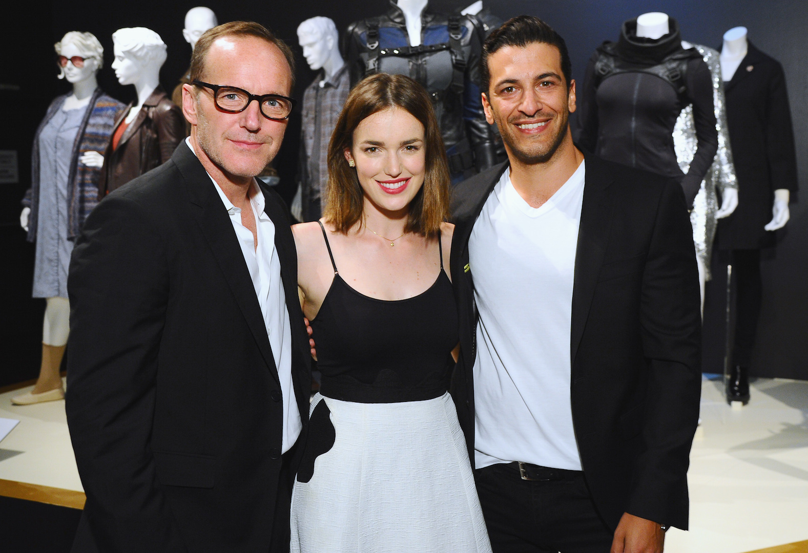 "Clark Gregg, from left, Elizabeth Henstridge and Simon Kassianides, of ""Marvel's Agents of S.H.I.E.L.D."" at The 9th Annual Outstanding Art of Television Costume Design Exhibition opening at the FIDM Museum & Galleries on the Park on Saturday, July 18, 2015, in Los Angeles. The Television Academy and FIDM Museum honored this year's Emmy(R) Award winners in Outstanding Costume Design at the opening reception for this annual special exhibition. (Photo by Vince Bucci/Invision for the Television Academy/AP Images)"