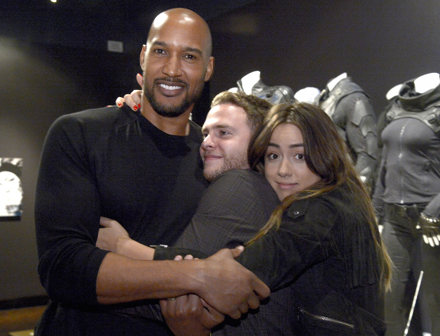 Henry Simmons, from left,  Iain De Caestecker and Chloe Bennet seen at The 9th Annual Outstanding Art of Television Costume Design Exhibition opening at the FIDM Museum & Galleries on the Park on Saturday, July 18, 2015, in Los Angeles. The Television Academy and FIDM Museum honored this year's Emmy(R) Award winners in Outstanding Costume Design at the opening reception for this annual special exhibition. (Photo by Phil McCarten/Invision for the Television Academy/AP Images)