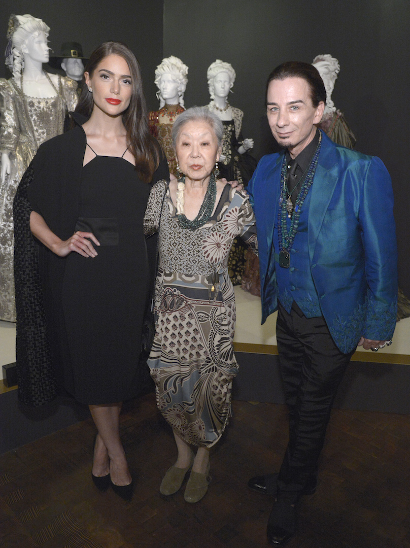 "Janet Montgomery, from left, Mary Rose and Joseph Porro, costume designer of ""Salem"" and ""The Lizzie Borden Chronicles"" seen at The 9th Annual Outstanding Art of Television Costume Design Exhibition opening at the FIDM Museum & Galleries on the Park on Saturday, July 18, 2015, in Los Angeles. The Television Academy and FIDM Museum honored this year's Emmy(R) Award winners in Outstanding Costume Design at the opening reception for this annual special exhibition. (Photo by Phil McCarten/Invision for the Television Academy/AP Images)"