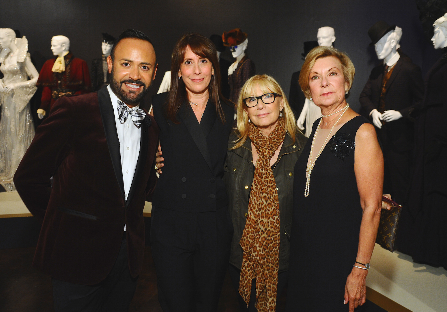 "Nick Verreos, from left, Ann Foley, costume designer of ""Marvel's Agents of S.H.I.E.L.D"", Ellen Mirojnick, costume designer of ""The Knick"" and Barbara Bundy, FIDM museum director seen at The 9th Annual Outstanding Art of Television Costume Design Exhibition opening at the FIDM Museum & Galleries on the Park on Saturday, July 18, 2015, in Los Angeles. The Television Academy and FIDM Museum honored this year's Emmy(R) Award winners in Outstanding Costume Design at the opening reception for this annual special exhibition. (Photo by Vince Bucci/Invision for the Television Academy/AP Images)"