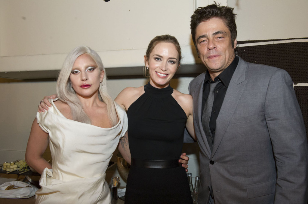 Beverly Hills, CA. August 13, 2015 Hollywood Foreign Press Association presents annual Grants Dinner Thursday night from the Beverly Wilshire Hotel. The HFPA will present more than $2 million in donations to non-profit entertainment-related organizations and scholarship programs. Pictured: Lady Gaga accepts for the Music Center / Young Musicians Foundation with Emily Blunt and John Krasinsky.