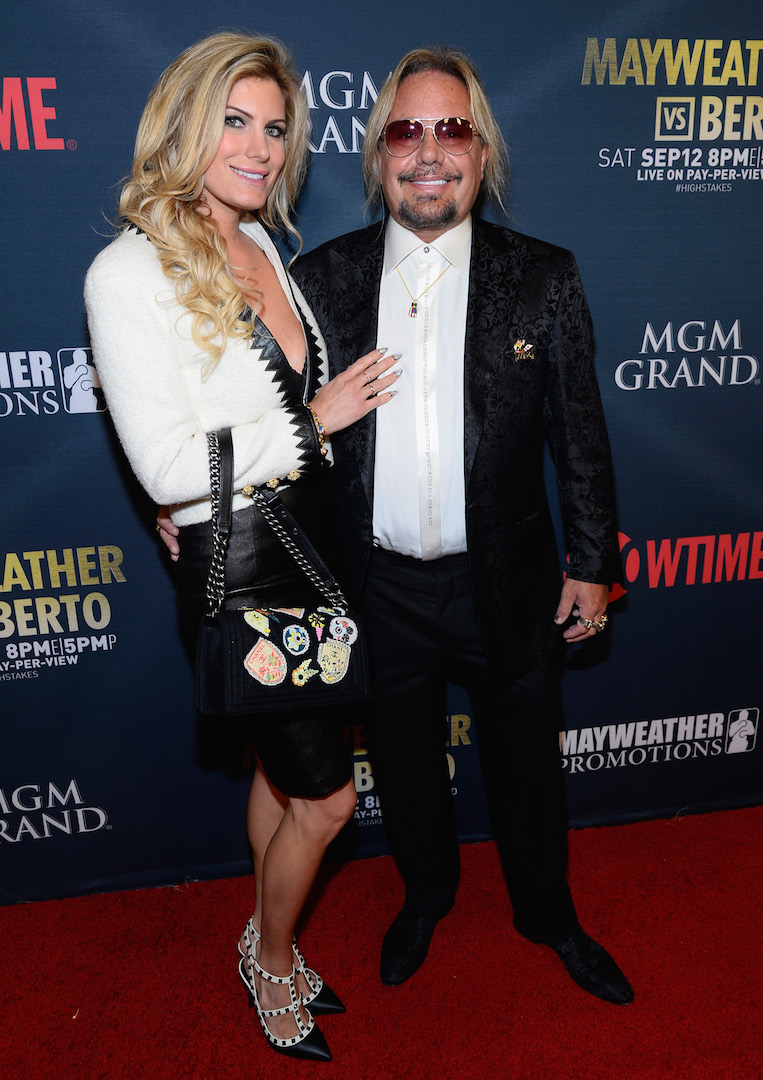 LAS VEGAS, NV - SEPTEMBER 12:  Makeup artist Rain Hannah (L) and Motley Crue Singer Vince Neil arrive at the VIP Pre-Fight Party for 'High Stakes: Mayweather v. Berto' presented by Showtime at the MGM Grand Garden Arena on September 12, 2015 in Las Vegas, Nevada.  (Photo by Bryan Steffy/Getty Images for Showtime) *** Local Caption *** Rain Hannah; Vince Neil