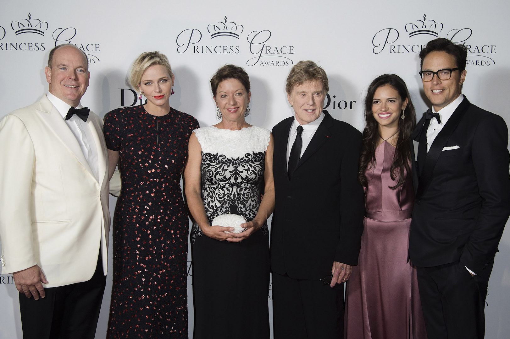 MONTE-CARLO, MONACO - SEPTEMBER 05:  (L-R) His Serene Highness Prince Albert II of Monaco, Her Serene Highness Princess Charlene of Monaco, 2015 Princess Grace Awards Gala Honorees Sibylle Szaggars Redford and Robert Redford, Daniella Perez Lopez and Cary Fukunaga (Princess Grace Statue Award Recipient) attend the 2015 Princess Grace Awards Gala With Presenting Sponsor Christian Dior Couture at Monaco Palace on September 5, 2015 in Monte-Carlo, Monaco.  (Photo by Pascal Le Segretain/Getty Images for Princess Grace Foundation-USA)