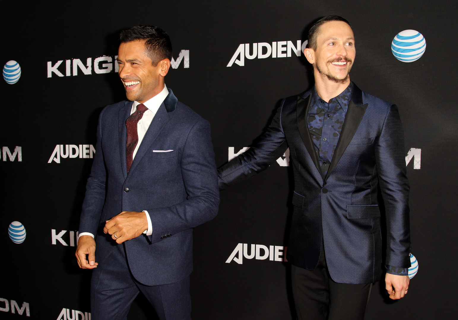 WEST HOLLYWOOD, CA - OCTOBER 06:  Actors Mark Consuelos (L) and Jonathan Tucker celebrate the season premiere of DIRECTV's KINGDOM on October 6, 2015 in West Hollywood, California.  (Photo by Rachel Murray/Getty Images for DIRECTV)