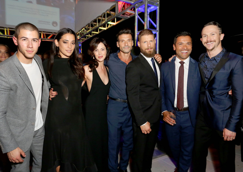WEST HOLLYWOOD, CA - OCTOBER 06: (L-R) Actors Nick Jonas, Natalie Martinez, Joanna Going, Frank Grillo, Matt Lauria, Mark Consuelos, and Jonathan Tucker celebrate the season premiere of DIRECTV's KINGDOM on October 6, 2015 in West Hollywood, California. (Photo by Rachel Murray/Getty Images for DIRECTV)