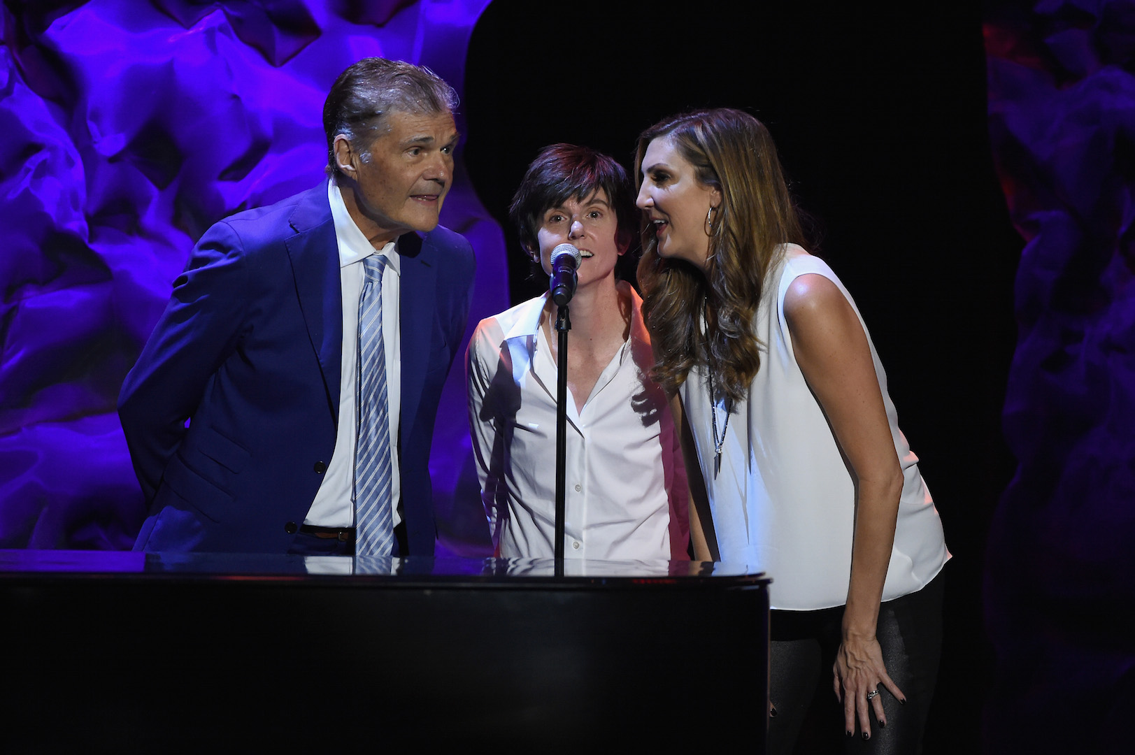 LOS ANGELES, CA - OCTOBER 10:  (L-R) Fred Willard, Tig Notaro and Heather McDonald sing backup onstage during the 9th Annual Comedy Celebration, presented by the International Myeloma Foundation, at The Wilshire Ebell Theatre on October 10, 2015 in Los Angeles, California.  (Photo by Kevin Winter/Getty Images for International Myeloma Foundation)