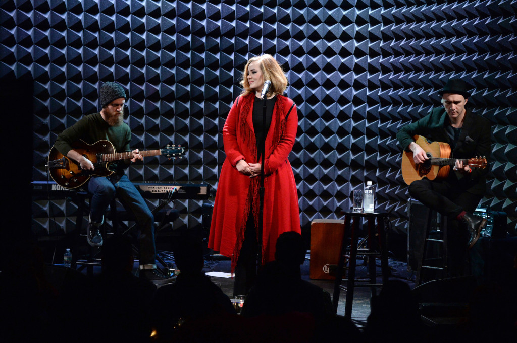 Adele performs onstage during iHeartRadio presents Adele's album premiere live at Joe's Pub on November 20, 2015 in New York City. (Photo by Kevin Mazur/Getty Images for iHeartRadio)