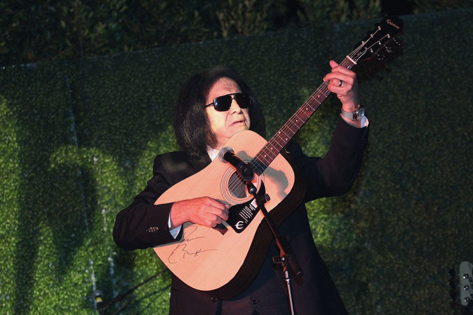BEVERLY HILLS, CA - NOVEMBER 07:  Musician Gene Simmons performs on stage at the Children Matter.NGO first annual gala on November 7, 2015 in Beverly Hills, California.  (Photo by Tommaso Boddi/Getty Images for The Children Matter.NGO)