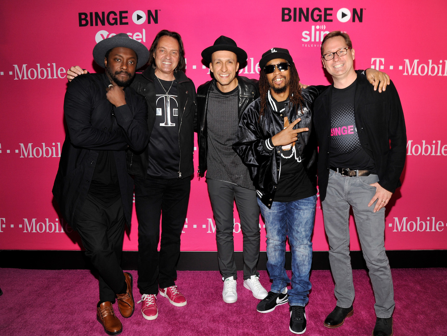 LOS ANGELES, CA - NOVEMBER 10:  (L-R) Singer-songwriter will.i.am, President and CEO of T-Mobile John Legere, DJ Vice, hip-hop artist Lil Jon and COO of T-Mobile Mike Sievart attend T-Mobile Un-carrier X Launch Celebration at The Shrine Auditorium on November 10, 2015 in Los Angeles, California.  (Photo by John Sciulli/Getty Images for T-Mobile)