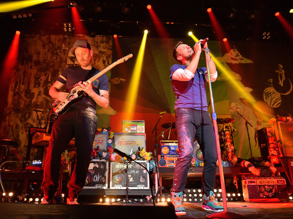 Guitarist Jonny Buckland and singer Chris Martin of Coldplay perform on stage at iHeartMedia Presents The iHeartRadio Album Release Party at iHeartRadio Theater on November 19, 2015 in Burbank, California. (Photo by Mike Windle/Getty Images for iHeartMedia)