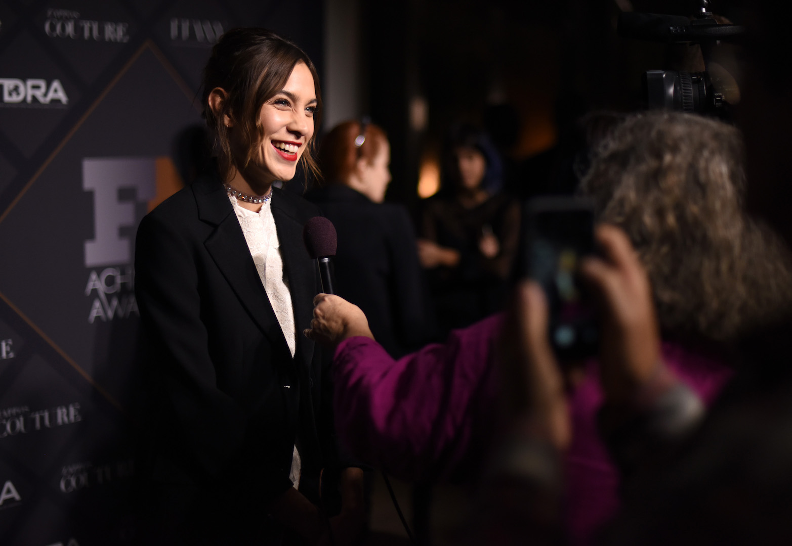 Mandatory Credit: Photo by Stephen Lovekin/Variety/REX Shutterstock (5470209cg) Alexa Chung with interviewer Footwear News Achievement Awards, Arrivals, New York, America - 02 Dec 2015
