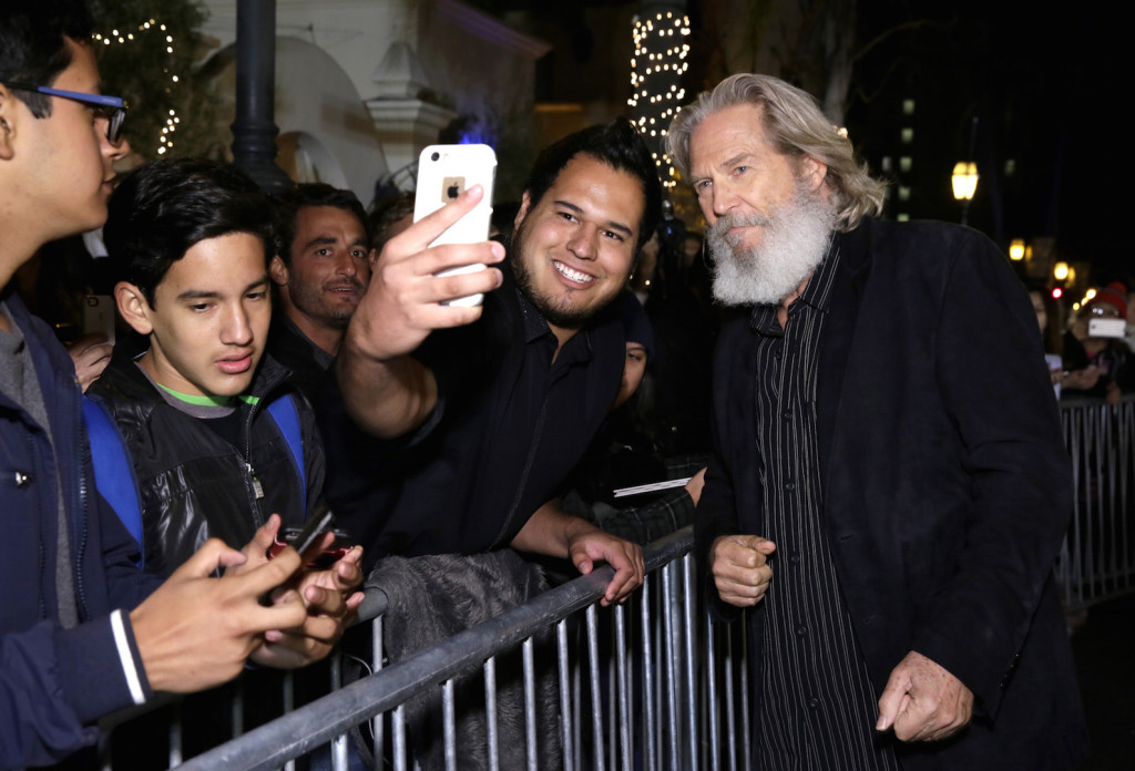 SANTA BARBARA, CA - FEBRUARY 03: Actor Jeff Bridges and a fan take selfies at the opening night presentation of 'The Little Prince' at the Arlington Theater during the 31st Santa Barbara International Film Festival on February 3, 2016 in Santa Barbara California. (Photo by Rebecca Sapp/Getty Images for Santa Barbara International Film Festival)