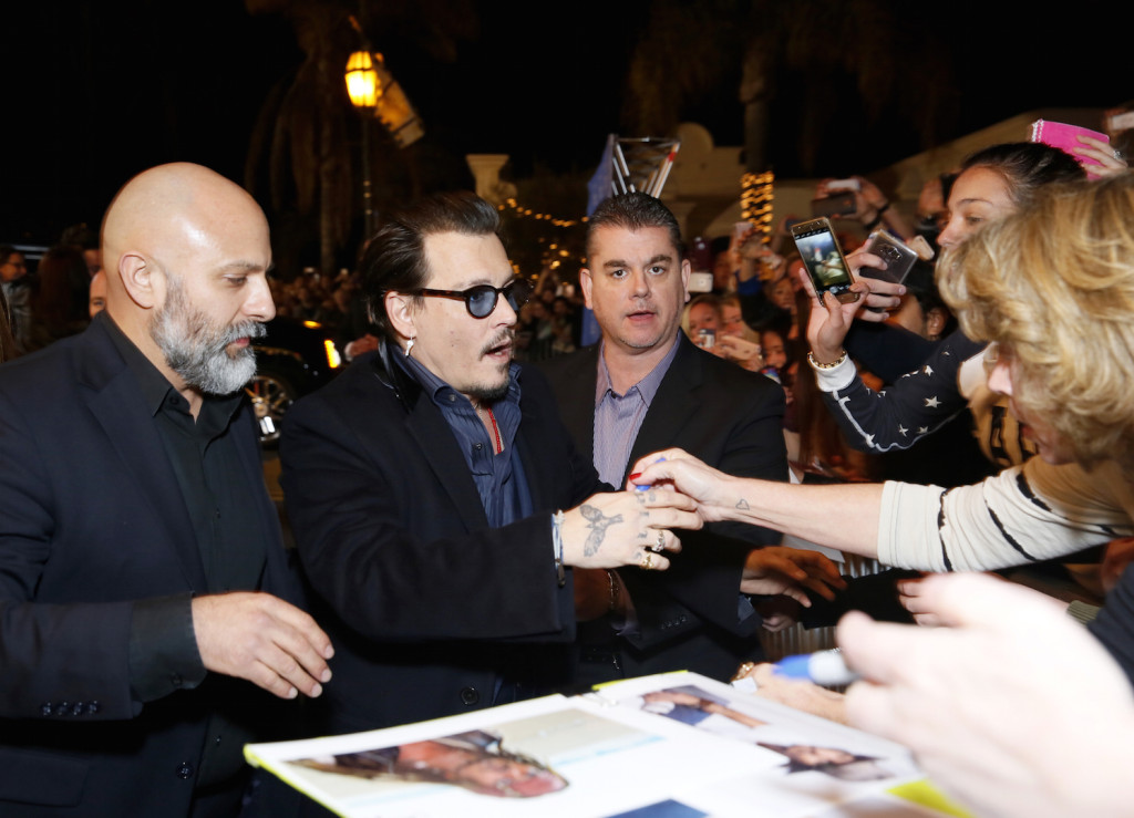 Actor Johnny Depp signs autographs for fans at the Maltin Modern Master award tribute during the 31st Santa Barbara International Film Festival at the Arlington Theater on February 4, 2016 in Santa Barbara, California. (Photo by Rebecca Sapp/Getty Images for Santa Barbara International Film Festival)