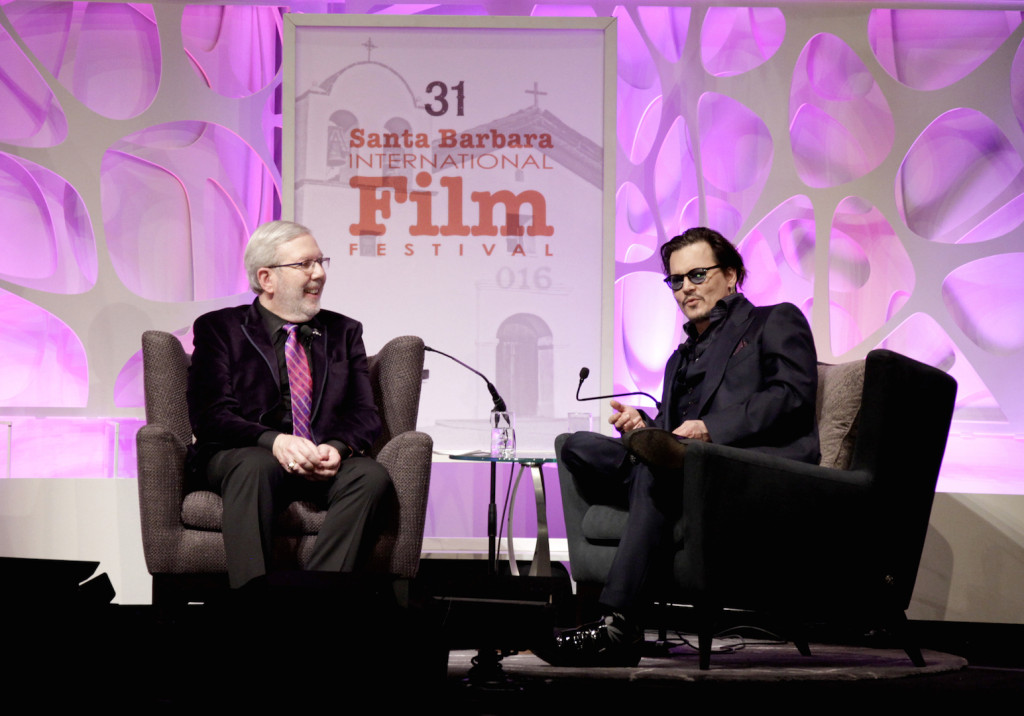 Film Critic Leonard Maltin and ActorJohnny Depp speak onstage at the Maltin Modern Master award tribute during the 31st Santa Barbara International Film Festival at the Arlington Theater on February 4, 2016 in Santa Barbara, California. (Photo by Rebecca Sapp/Getty Images for Santa Barbara International Film Festival)